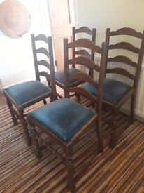 4 wooden dining chairs with blue cushion seat