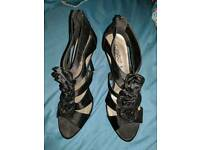 Black rose high heels never worn