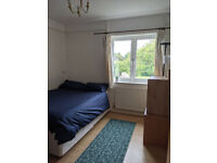 Bright double bedroom in a furnished house