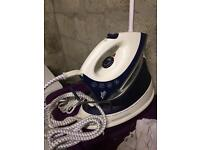 Steam iron with base