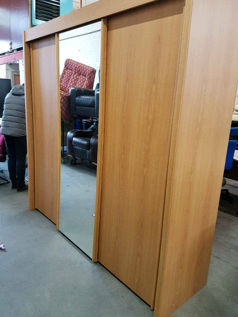 Large sliding door wardrobe with cherrywood finish