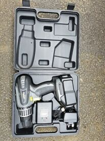 Cordless drill with charger and case