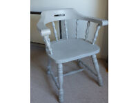 Captains Chair painted in a light grey/blue.