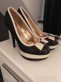 Cream/black heels