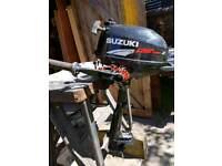 Suzuki 2.5 HP 4 stroke short shaft engine.