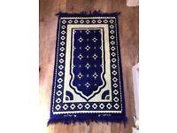 2 blue rugs