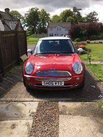 red Mini Cooper 1.6 petrol