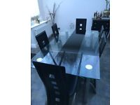 Glass Black Dining Table with 6 chairs (+2 spares)