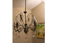 Chandelier (large), contemporary style, in brushed metal with glass drops with five light bulbs.