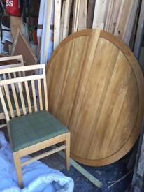 Solid oak extending round table and 4 oak chairs