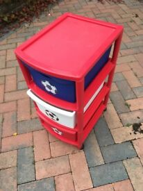 Set of red child's drawers