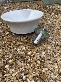 Round basin and tap fitting