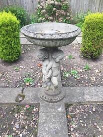 Concrete bird bath