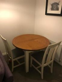 Solid oak dining table and 4 matching chairs