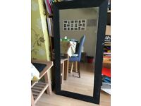 Mirror with large black wooden frame