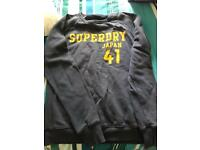 Superdry sweatshirt size M. Blue but faded due to washing