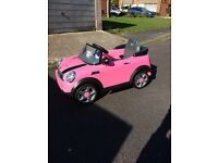 2 brand new, never used electric mini coopers