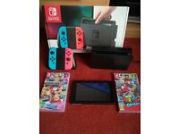 Nintendo Switch - Excellent condition with Super Mario Odyssey and Mario Kart 8 Delux