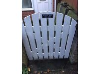 White garden gate 3ft wide with black hinges.