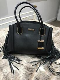 BLACK TASSLE RIVER ISLAND BAG