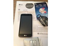 LG K120E PHONE BRAND NEW 02 WHITE CASE SILVER AT SIDE PAY AS YOU GO