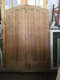 A pair of arched top pine door's