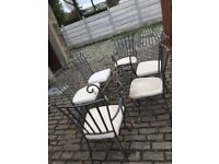 Wrought Iron twisted rope patio furniture.