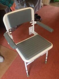 Fold down shower chair