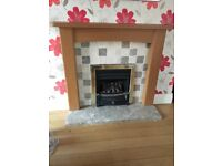 Oak fire surround and solid marble hearth excellent condition. Hearth 4ft x 1.3ft x2in