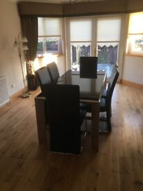 Black Glass high gloss dining table with 6 x high back leather chairs and matching side table