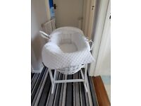 Moses basket like new only used for three months. Includes stand and matteress