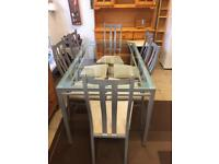 Dining table and 6 chairs, glass and silver metal