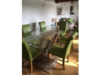 Dinning table and 6 soft leather chairs.