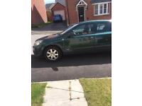 Green Vauxhall Astra Life 55 plate