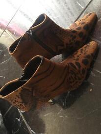 Women's size 4 cheetah mini boots
