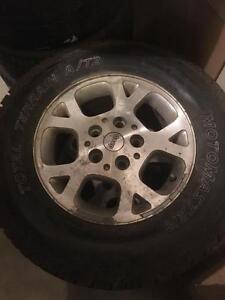 4-235/70R16  TOTAL TERRAIN AT TIRES  ON JEEP WHEELS 127 bolt pattern FOR  GRAND CHEROKEE  $500 set