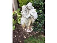 Garden statue of couple embracing