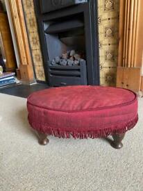 Antique small upholstered burgundy footstool