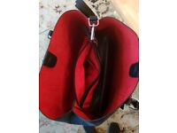 Brand new Black womens handbag Medium size. Red inside. Never worn.