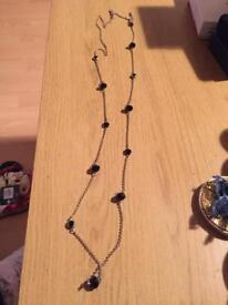 Long necklace with black beads