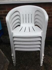 6 white plastic chairs (5in picture)