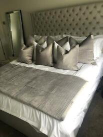 Three large luxury velvet-feel cushions with feather inserts