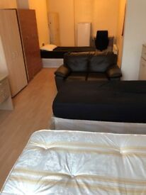 Massive Room with 3 single beds and a private Toilet. Acton Central. West London. All bills included