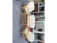 2 seater sofa, 2 chairs and a glass table