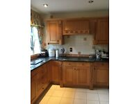 Wood fitted kitchen with granite work top and appliances.