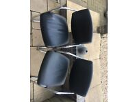 Four black and metal modern dining chairs