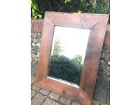 Lovely dark wooden chunky mirror