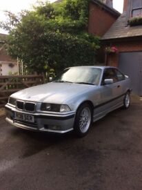 Bmw E36 328i sport for sale. Arctic silver, automatic, black leather, 92,596, becoming rare.