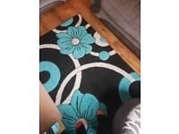 Teal, grey and black rug