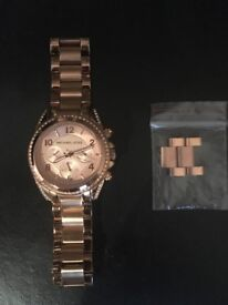 Micheal kors ladies watch in rose gold with crystals round the face Must be seen!